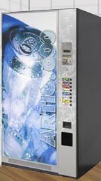 ...новый автомат для продажи прохладительных напитков Jofemar Artic 600.